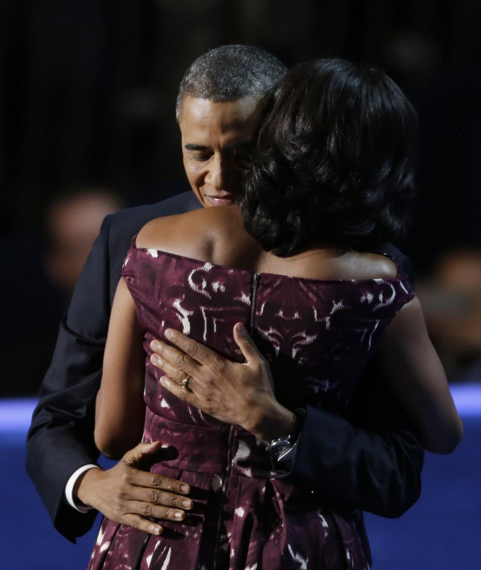 President Barack Obama hugs his wife First lady Michelle Obama at the Democratic National Convention in Charlotte, N.C., on Thursday, Sept. 6, 2012. (AP Photo/Lynne Sladky)
