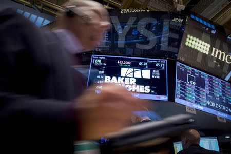 Traders work by the post that trades Baker Hughes on the floor of the New York Stock Exchange