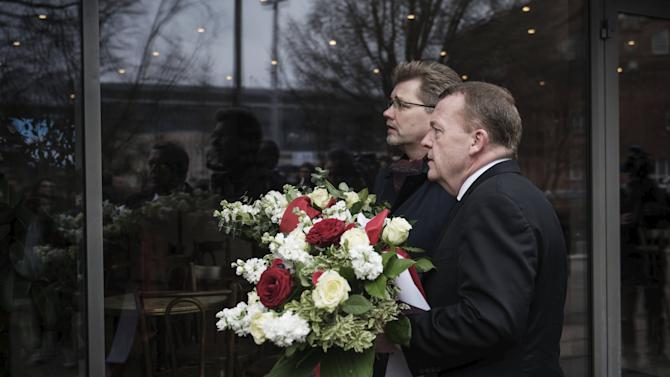 Danish Prime Minister Lars Lokke Rasmussen and Mayor of Copenhagen Frank Jensen lay flowers at Krudttonden in Copenhagen