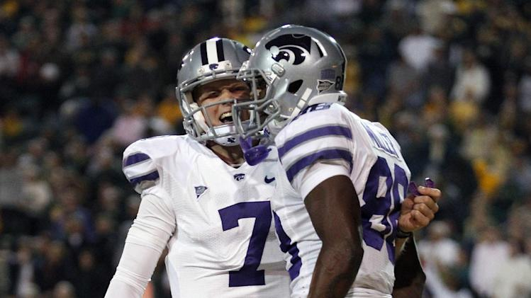 Kansas State quarterback Collin Klein (7) celebrates a touchdown pass with teammate wide receiver Torell Miller (88) during the first quarter of an NCAA college football game against the Baylor on Saturday, Nov. 17, 2012, in Waco, Texas. (AP Photo/LM Otero)