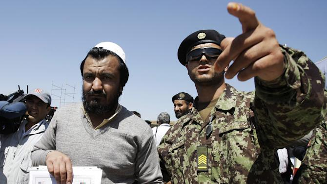 An Afghan soldier, right, escorts a released prisoner, Mohammad Karim, following a hand over ceremony of U.S.- run prison to Afghan government in Bagram north of Kabul, Afghanistan, Monday, Sept. 10, 2012. U.S. officials handed over formal control of Afghanistan's only large-scale U.S.-run prison to Kabul on Monday, even as disagreements between the two countries over the thousands of Taliban and terror suspects held there marred the transfer. (AP Photo/Musadeq Sadeq)