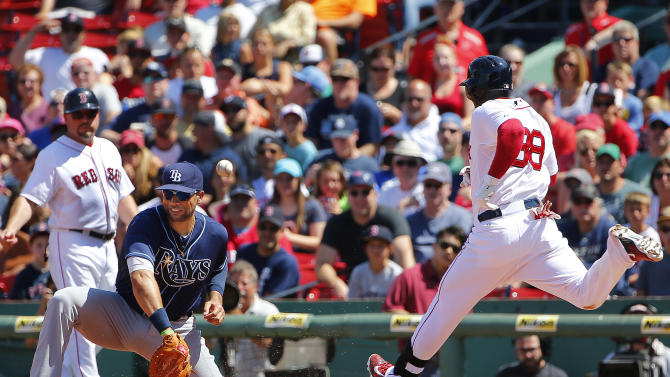 Tampa Bay Rays first baseman James Loney can't handle the throw as Boston Red Sox's Rusney Castillo is safe on an infield single during the third inning of a baseball game at Fenway Park in Boston, Saturday, Aug. 1, 2015. (AP Photo/Winslow Townson)
