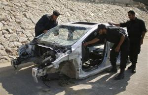 Hamas naval police inspect parts of a car which they…
