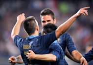 French forward Franck Ribery celebrates with teammates after scoring a goal during the friendly football match France vs Iceland on May 27