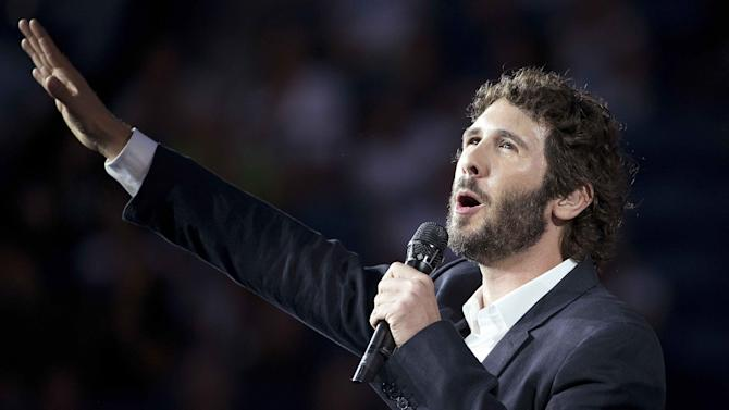 American singer Josh Groban performs during the opening ceremonies at the U.S. Open Championships tennis tournament in New York