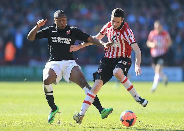 Sheffield United's Jamie Murphy, right, is brought down by Charlton Athletic's Callum Harriott during the FA Cup Sixth Round match at Bramall Lane, Sheffield, Sunday March 9, 2014