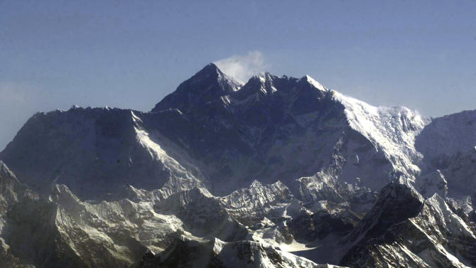"FILE - In this Tuesday, May 6, 2003 file photo, Mount Everest, at 8,850-meter (29,035-foot), the world's tallest mountain situated in the Nepal-Tibet border as seen from an airplane. Days after four people died amid a ""traffic jam"" of climbers scrambling to conquer Mount Everest, Nepal officials said a similar rush up the world's tallest peak will begin soon, and there's little they can do to control it. (AP Photo/Binod Joshi, File)"