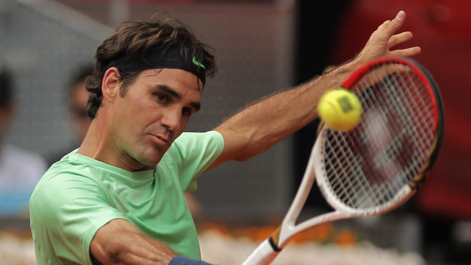 Roger Federer from Switzerland returns the ball during the match against Radek Stepanek from Czech Republic at the Madrid Open tennis tournament, in Madrid, Tuesday, May 7, 2013. (AP Photo/Andres Kudacki)
