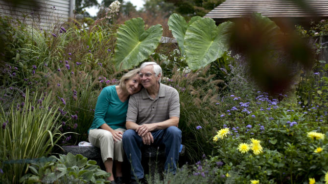 """In this photo taken Oct. 5, 2012, independent voters Thyra and Joe Galli relax in their flower garden, in Portsmouth, N.H. Thyra plans to vote for Obama and Joe is supporting Romney. New Hampshire's nickname is """"the Granite State"""" but there's nothing solid about its political landscape. Independent voters have been the reason in recent presidential elections. Today, former factory towns to the south _ Manchester and Nashua _ typically vote Republican as do the rural small towns up north, while state capital Concord and university towns like Durham, Dover, Keene and Hanover tend to lean Democratic. And the entire state is peppered with independents like Joe and Thyra Galli of Portsmouth. (AP Photo/Robert F. Bukaty)"""