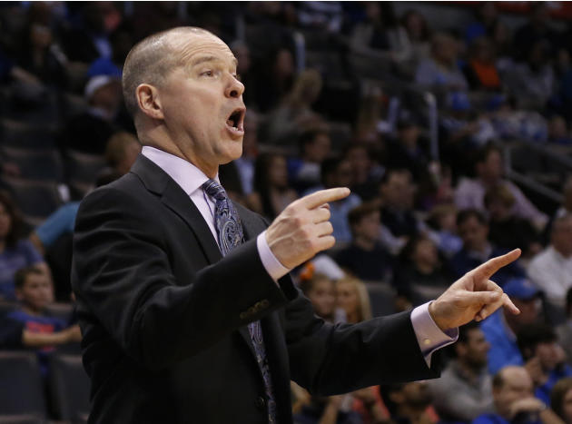 Sacramento Kings head coach Michael Malone directs his team in the fourth quarter of an NBA basketball game against the Oklahoma City Thunder in Oklahoma City, Sunday, Jan. 19, 2014. Oklahoma City won