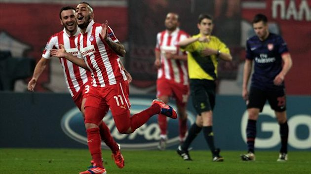 Olympiacos' Kostas Mitroglou (C) celebrates after scoring during the Champions League Group B match at the Karaiskaki stadium in Piraeus near Athens (AFP)