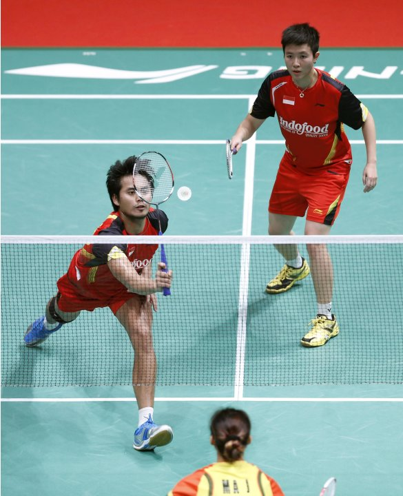 Indonesia's Tontowi with partner Lilyana plays a shot during their mixed doubles badminton match against China's Xu and Ma at the quarterfinals of the Sudirman Cup World Team Badminton Championships i