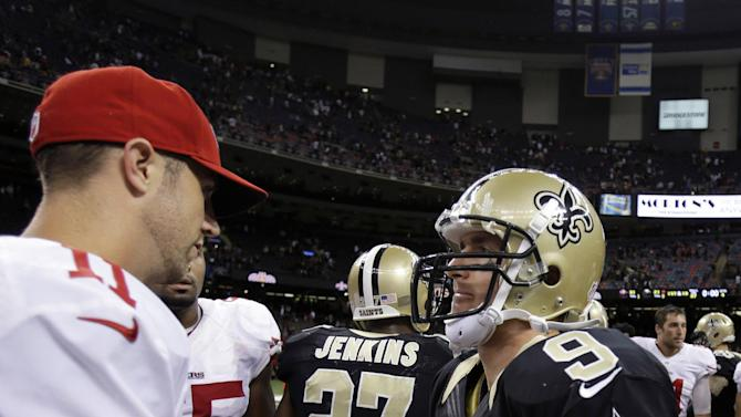 New Orleans Saints quarterback Drew Brees (9) shakes hands with San Francisco 49ers quarterback Alex Smith (11) after an NFL football game in New Orleans, Sunday, Nov. 25, 2012. The 49ers won 31-21. (AP Photo/Bill Haber)