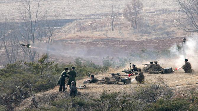 """FILE - In this file photo released Monday, Feb. 25, 2013, by the Korean Central News Agency (KCNA) and distributed Tuesday, Feb. 26 by the Korea News Service, a Korean People's Army artillery unit participate in a live fire drill while North Korean leader Kim Jong Un, unseen, inspects the unit at an undisclosed location, in North Korea. North Korea's military, founded 81 years ago Thursday, April 25, is older than the country itself. It began as an anti-Japanese militia and is now the heart of the nation's """"military first"""" policy. Late leader Kim Jong Il elevated the military's role during his 17-year rule, boosting troop levels to an estimated 1.2 million soldiers, according to the South Korean government. The military's new supreme commander, Kim Jong Un, gave the Korean People's Army a sharpened focus this year by instructing troops to build a """"nuclear arms force."""" (AP Photo/KCNA via KNS, File)"""