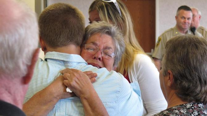 Family members hug outside of court after Susan Hendricks was sentenced to life in prison on Friday, April 26, 2013, in Pickens, S.C. Hendricks pleaded guilty but mentally ill to killing four family members in October 2011 in Liberty. (AP Photo/Jeffrey Collins)