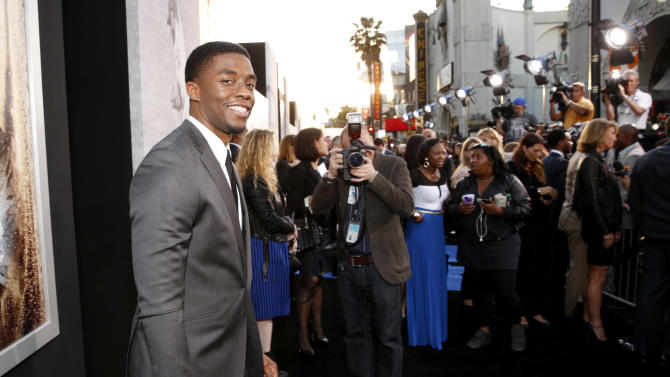 """Chadwick Boseman arrives at the LA premiere of """"42"""" at the TCL Chinese Theater on Tuesday, April 9, 2013 in Los Angeles. (Photo by Todd Williamson /Invision/AP)"""