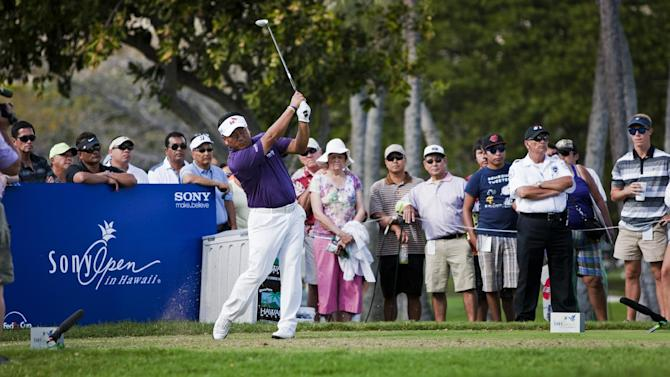K.J. Choi, of South Korea, follows his shot off the 11th tee during the first round of the Sony Open golf tournament on Thursday, Jan. 10, 2013, in Honolulu. (AP Photo/Marco Garcia)