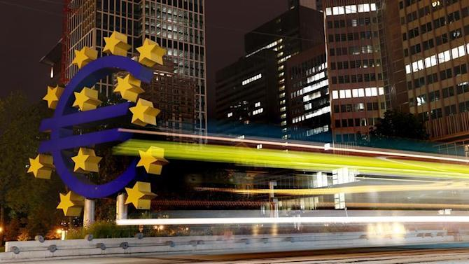 A tram runs past the euro sign landmark outside the headquarters of the European Central Bank (ECB) in Frankfurt