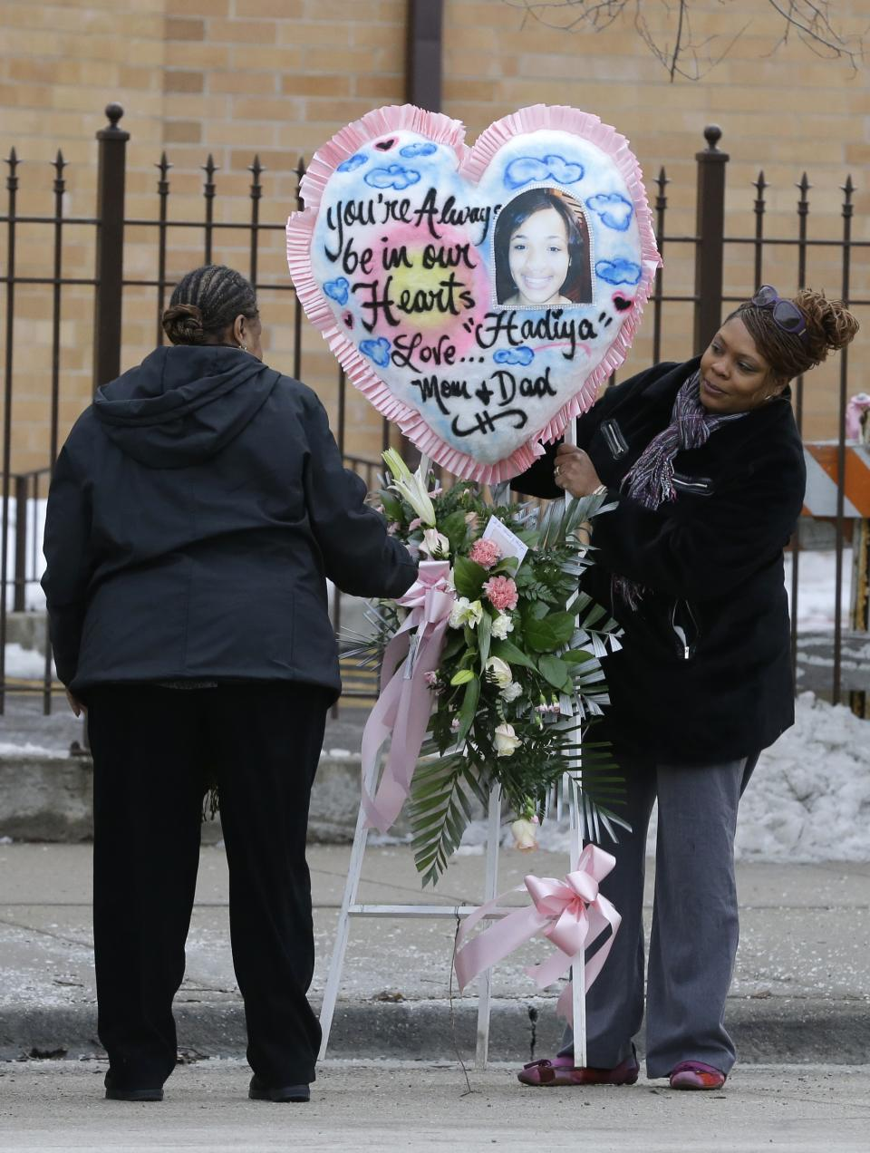A floral arrangement is delivered at the Greater Harvest Missionary Baptist Church for the funeral service of Hadiya Pendleton Saturday, Feb. 9, 2013, in Chicago. The shooting death of the 15-year-old honor student has drawn attention to the staggering gun violence in the nation's third-largest city. (AP Photo/Nam Y. Huh)