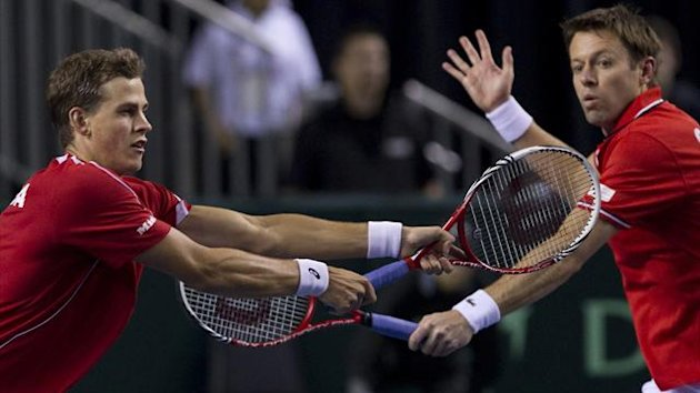 Canada's Vasek Pospisil (L) and teammate Daniel Nestor hit a return to Italy's Daniele Bracciali and Fabio Fognini during doubles play at the second round of the Davis Cup tennis tournament in Vancouver (Reuters)