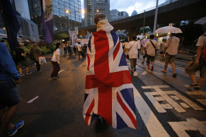 A protester wraps himself with a Hong Kong colonial …