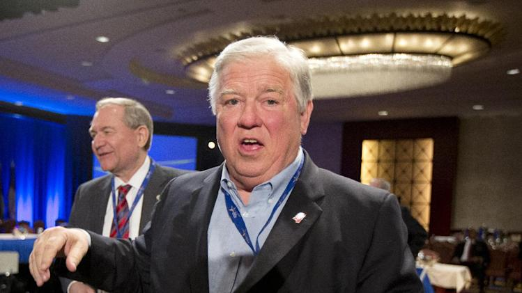 """Former Mississippi Gov. Haley Barbour leaves a Health and Homeland Security Committee meeting titled """"Protecting Our Nation: States and Cybersecurity"""" during the National Governors Association 2013 Winter Meeting in Washington on Saturday, Feb. 23, 2013. Former Virginia Gov. Jim Gilmore is at left. (AP Photo/Manuel Balce Ceneta)"""