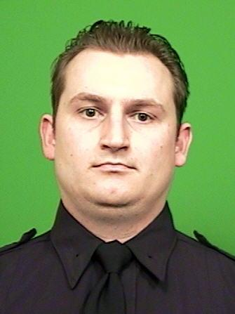 This image provided by the New York City Police Department shows officer Lukasz Kozicki, 32, who was struck three times Thursday Jan. 3, 2013; once in each of his upper thighs and once in the groin when he and officer Michael Levay confronted a man on a Manhattan-bound N train. Officer Michael Levay was shot in the lower back, but his vest stopped the bullet. He returned fire, killing the suspect. (AP Photo/New York City Police Department)