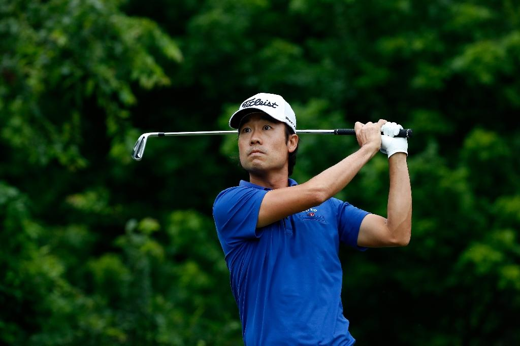 Na leads Poulter by two as Spieth struggles