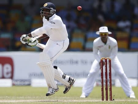 Sri Lanka's Perera reacts for a bouncer ball by South Africa's Morkel (not pictured) during the second day of their second test cricket match in Colombo