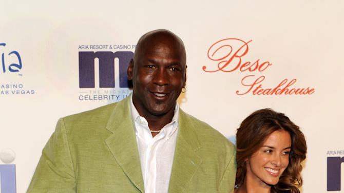 In this photo provided by the Las Vegas News Bureau, basketball great Michael Jordan and his girlfriend Yvette Prieto arrive for a celebrity dinner at Beso inside Crystals in City Center Thursday, March 31, 2011. Celebrities are in Las Vegas for the Michael Jordan Celebrity Invitational golf tournament at Shadow Creek in Las Vegas. (AP Photo/Las Vegas News Bureau, Brian Jones)