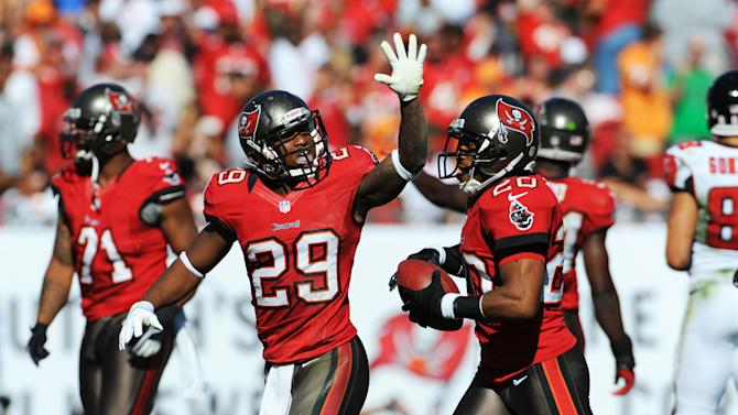TAMPA, FL - NOVEMBER 25: Defensive back Ronde Barber #20 of the Tampa Bay Buccaneers celebrates a second-quarter interception with cornerback Leonard Johnson #29 against the Atlanta Falcons November 25, 2012 at Raymond James Stadium in Tampa, Florida. (Photo by Al Messerschmidt/Getty Images)