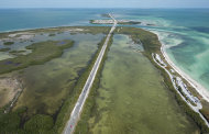 This March 10, 2013, photo provided by the Florida Keys News Bureau shows traffic on the Florida Keys Overseas Highway at Bahia Honda Key, Fla. The toll-free road connects inhabited islands in the Florida Keys archipelago and features 42 bridges over the water. (AP Photo/Florida Keys News Bureau, Andy Newman)
