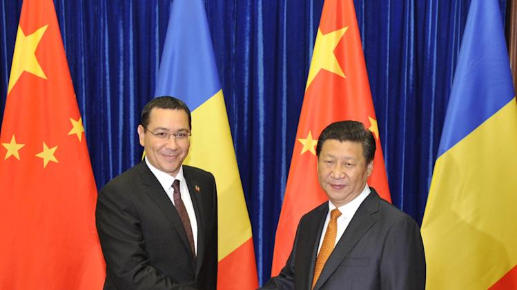 Chinese President Xi Jinping, right, shakes hands with Romanian Prime Minister Victor Ponta before their meeting at the Great Hall of the People in Beijing, China, Tuesday, Sept. 2, 2014. (AP Photo/Parker Song, Pool).