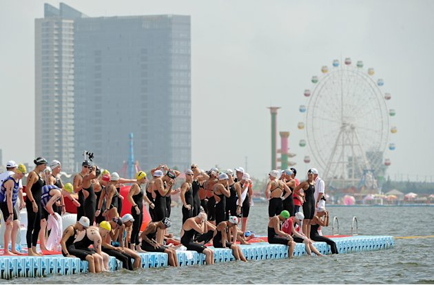 Competitors get ready before the women's 10km open water swimming event of the FINA World Championships in Shanghai on July 19, 2011. British swimmer Keri-Anne Payne, who took silver at the 2008 B