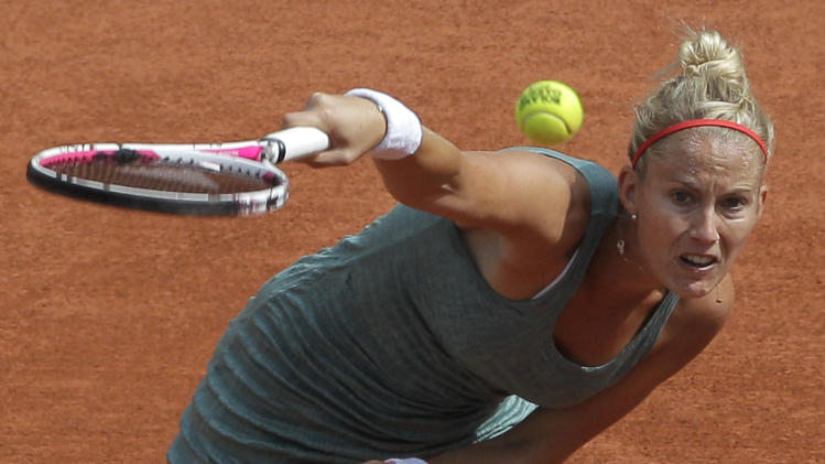 France's Mathilde Johansson serves the ball to USA's Sloane Stephens during their third round match in the French Open tennis tournament at the Roland Garros stadium in Paris, Friday, June 1, 2012.  (AP Photo/Michel Spingler)
