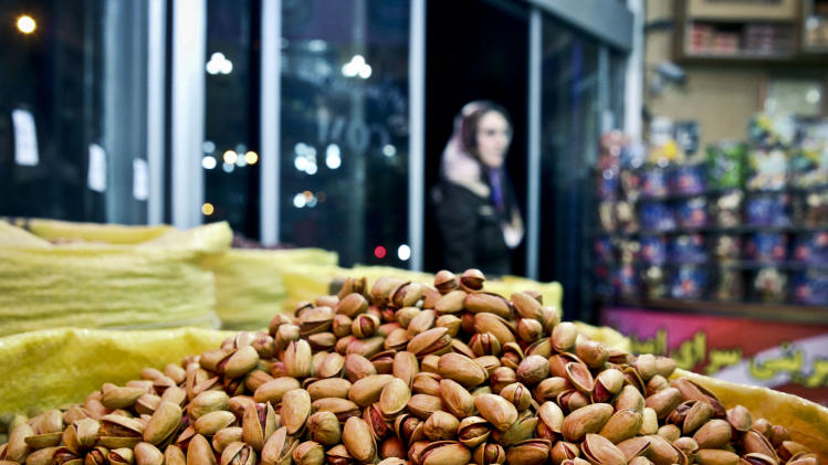 In this Sunday, March 31, 2013 photo, Pistachios are seen at a nut shop in western Tehran, Iran. Pistachios are Iran's top non-oil export and provide work for hundreds of thousands of people. Still, Iranian authorities are backing the boycott. They laud it as a way to decrease domestic pistachio consumption and leave more nuts for exporting, which has become an increasingly important pipeline for foreign revenue as sanctions squeeze Iran's oil and gas sales. (AP Photo/Ebrahim Noroozi)