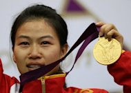 China's Yi Siling celebrates with her gold medal after winning the 10m air rifle women's final at the London 2012 Olympic Games at the Royal Artillery Barracks