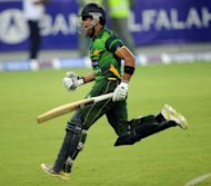 Pakistani batsman Umar Akmal celebrates after winning the second Twenty20 international cricket match against Australia. Pakistan beat Australia in a tense Super over finish