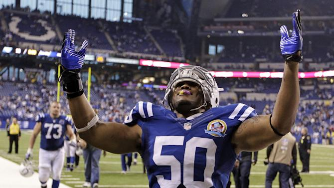 Indianapolis Colts' Jerrell Freeman (50) reacts to the fans after their 27-23 win over the Tennessee Titans in an NFL football game, Sunday, Dec. 9, 2012, in Indianapolis. (AP Photo/Michael Conroy)