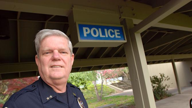 In this April 30, 2012 photo, Police Chief Terry Holderness poses outside his office in Ashland, Ore. Holderness says a new medical marijuana restaurant in town is not at the top of his priority list, but if authorities determine it violates the law, he will shut it down. (AP Photo/Jeff Barnard)