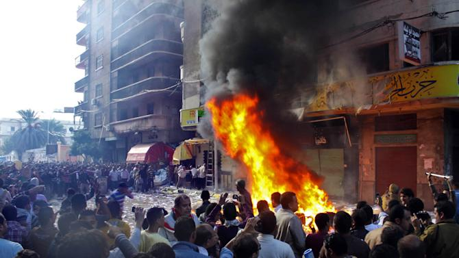 Protesters storm an office of Egyptian President Mohammed Morsi's Muslim Brotherhood Freedom and Justice party and set fires in the Mediterranean port city of Alexandria, Egypt, Friday, Nov. 23, 2012. State TV says Morsi opponents also set fire to his party's offices in the Suez Canal cities of Suez, Port Said and Ismailia. Opponents and supporters of  Morsi clashed across Egypt on Friday, the day after the president granted himself sweeping new powers that critics fear can allow him to be a virtual dictator. (AP Photo/Amira Mortada, El Shorouk Newspaper) EGYPT OUT