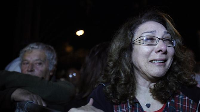 An employee of Laiki Bank cries during a protest outside the Cypriot parliament in Nicosia, Cyprus, Thursday, March 21, 2013. Cypriot officials were scrambling Thursday to cement a revised plan to raise funds demanded by international creditors in exchange for an international bailout Thursday, with time running out fast and the country's economy just days away from potential ruin. (AP Photo/Petros Karadjias)