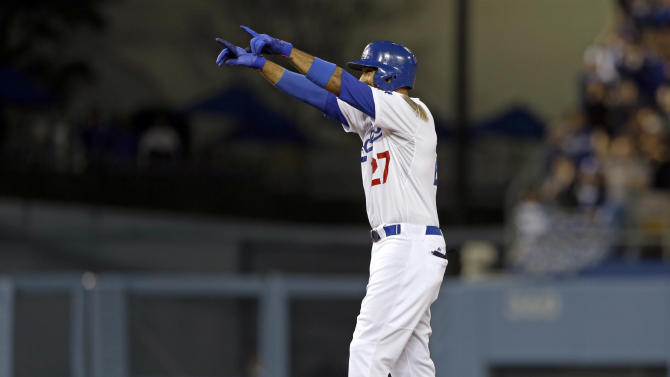 Los Angeles Dodgers' Matt Kemp celebrates at second after doubling in a run against the Pittsburgh Pirates in the sixth inning of a baseball game in Los Angeles Friday, April 5, 2013. (AP Photo/Reed Saxon)