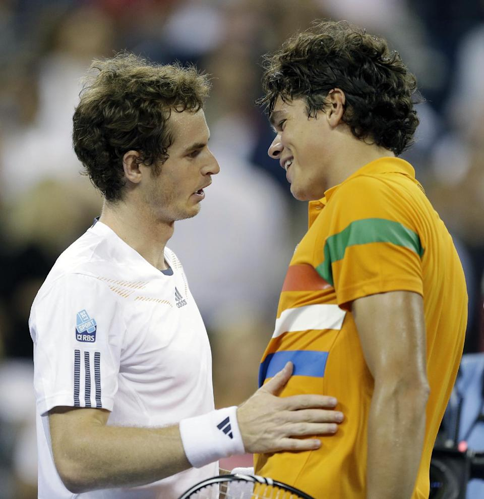 Andy Murray, left, of Britain, is congratulated by Milos Raonic, of Canada, after Murray defeated Raonic in a match during the U.S. Open tennis tournament, Monday, Sept. 3, 2012, in New York. Murray won 6-4, 6-4, 6-2. (AP Photo/Darron Cummings)
