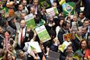 Brazilian deputies hold signs against Brazilian President Dilma Rousseff's impeachment during a session to discuss its admissibility in Brasilia on April 17, 2016