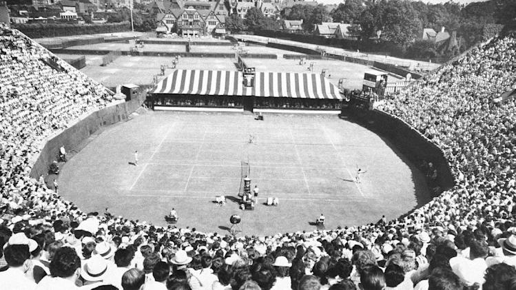 FILE - In this 1949 file photo, a championship match is played in the horseshoe stadium of the West Side Tennis Club in the Forest Hills neighborhood of the Queens borough of New York. The stadium that was one of the cathedrals of tennis and hosted US Open tennis for six decades; as well music greats; is planning to revive the sound of music at the 16,000-seat stadium and perhaps, one day, bring back big-time professional tennis. (AP Photo, File)