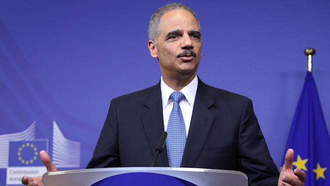U.S. Attorney General Eric Holder, addresses the media during the launching conference of the Global Alliance against Child Abuse Online, at the European Commission headquarters in Brussels, Wednesday, Dec. 5, 2012. At the launching conference, 47 countries worldwide joined forces to fight child sexual abuse online. (AP Photo/Yves Logghe)