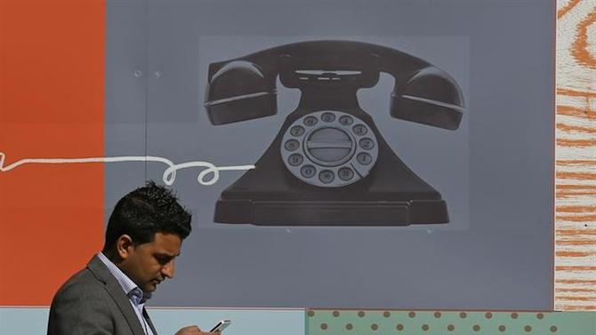 A man uses his mobile phone in central London September 2, 2013. REUTERS/Stefan Wermuth