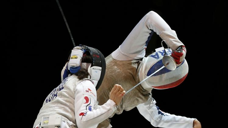 Nam of South Korea competes against Thibus of France in the women's team foil final match at the World Fencing Championships in Kazan