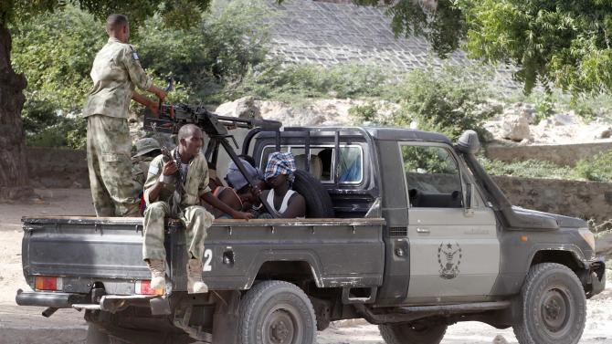 Somalia security forces transport blind-folded suspects detained on their pick-up truck after attackers from the militant group al Shabaab invaded the African Union in Somalia's capital Mogadishu